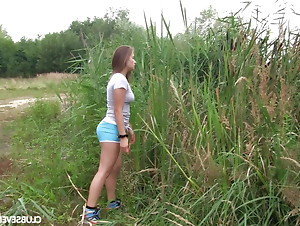 Handsome teen with big tits takes her shorts off and masturbates solo outdoors.